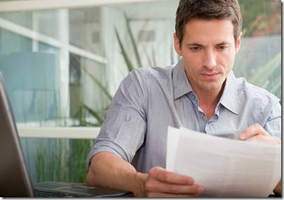Man reviewing insurance claim paperwork