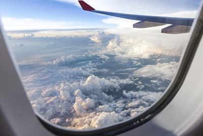 window of an airplane overlooking clouds