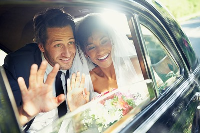 Shot of a newlywed couple looking out the window of a car and wavinghttp://195.154.178.81/DATA/i_collage/pu/shoots/784347.jpg