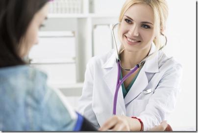 female medicine doctor measuring blood pressure