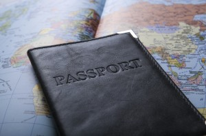 passport laying on top of a world map